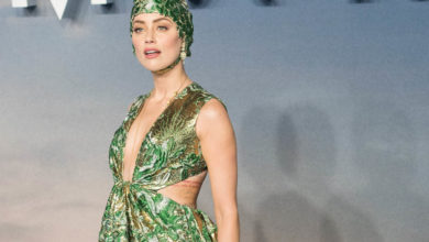 Amber Heard wears swimming cap to the Aquaman premiere