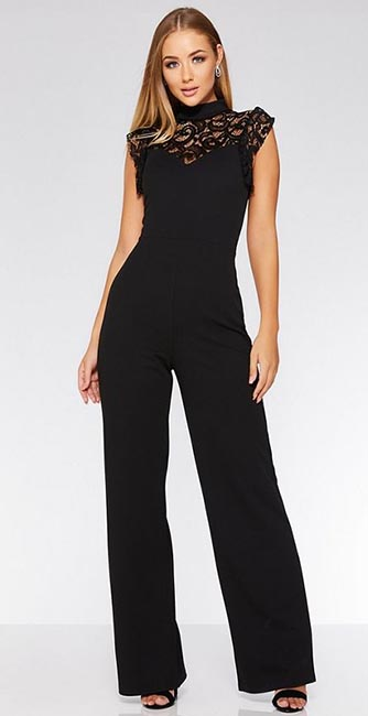 Front view of this Quiz Black lace frill high neck palazzo jumpsuit