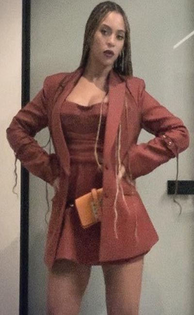 Beyonce poses in Burgundy blazer, top and mini skirt (Instagram) 2018