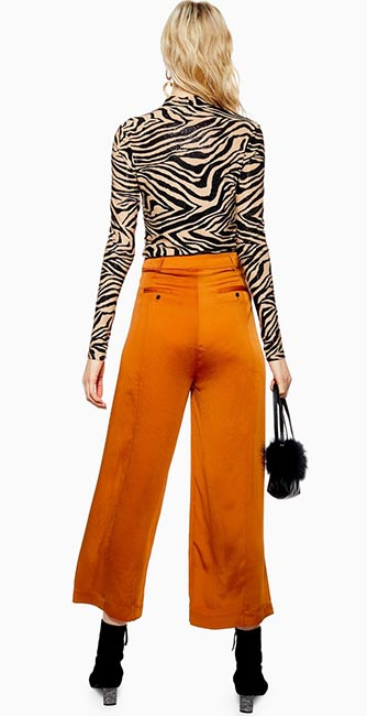 Rear view of these wide trousers by Native Youth from Topshop