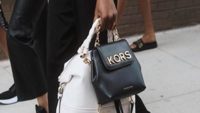 Michael Kors complete purchase of Versace